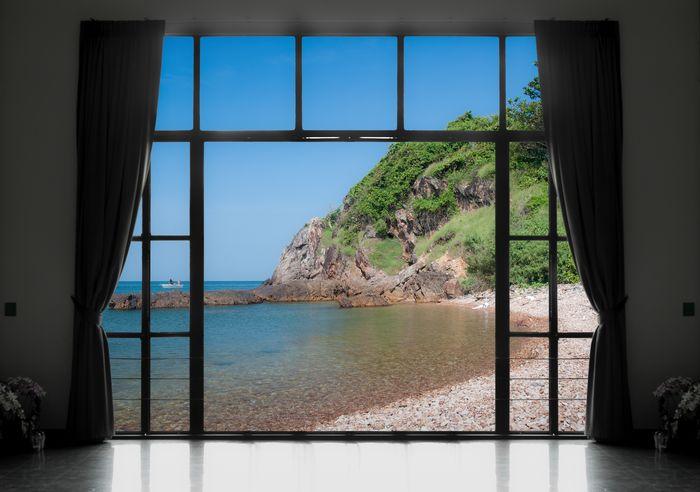 3D Фотообои «Окно с видом на каменистый пляж»